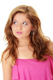 Beautiful brunette girl in hot pink. Royalty Free Stock Photography