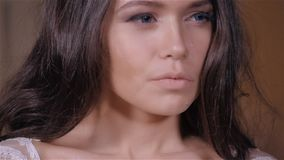 Beautiful brunette girl in the image of the Arab bride in a wedding dress and a crown on her head. Beauty face. Picture stock video footage