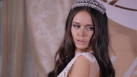 Beautiful brunette girl in the image of the Arab bride in a wedding dress and a crown on her head. Beauty face. Picture stock video