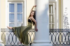 Beautiful Brunette Girl In A Long Cocktail Dress On The Balcony Of An Old House Royalty Free Stock Images