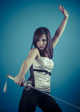 Beautiful brunette girl with Katana in studio Royalty Free Stock Photos