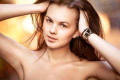 Beautiful brunette girl lifting up hair at street Royalty Free Stock Photo