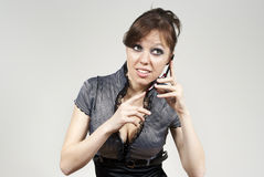 Beautiful brunette girl listening by phone. Beautiful brunette girl listening and talking on the phone Royalty Free Stock Photos