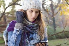 Beautiful brunette girl listening to music Royalty Free Stock Photo