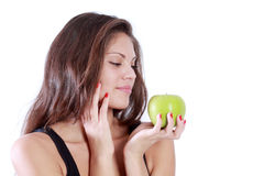 Beautiful brunette girl look at green apple Royalty Free Stock Photos
