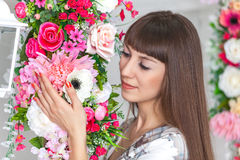 Beautiful brunette girl looking at the flowers. Spring royalty free stock images