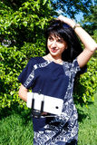 Beautiful brunette girl makes selfie photos using phone and mono Stock Photo