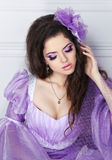 Beautiful brunette girl model with fashion jewelry, makeup and h. Airstyle. Fashionable woman wearing in dress. Art photo Royalty Free Stock Images