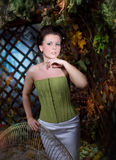 Beautiful brunette girl in mystical autumn garden Royalty Free Stock Photo