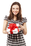 Brunette girl opening gift box. Beautiful brunette girl opening gift box, looking at camera Royalty Free Stock Photos