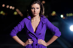 Beautiful brunette girl outside at night Stock Images