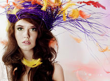 Beautiful brunette girl over feathers. Royalty Free Stock Photos