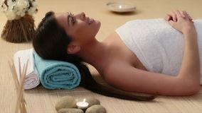 Beautiful brunette girl is pampered at the health spa stock footage