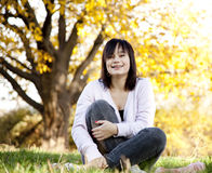 Beautiful brunette girl at the park. Royalty Free Stock Images