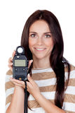 Beautiful brunette girl with a photometer Stock Photos
