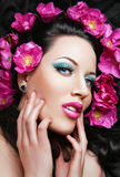 Beautiful brunette  girl with pink flowers in her Stock Photo