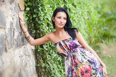 Beautiful brunette girl  posing near rock wall Royalty Free Stock Photography