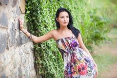 Beautiful brunette girl  posing near rock wall Royalty Free Stock Photos