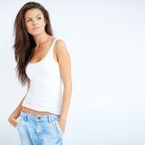 Beautiful brunette girl posing over white Royalty Free Stock Photography