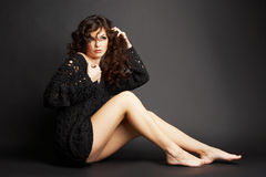 Beautiful brunette girl posing in studio stock image