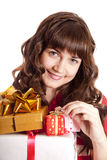 Beautiful brunette girl with present boxes. Royalty Free Stock Photography