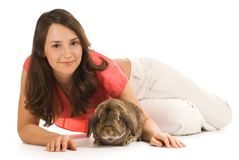 Beautiful brunette girl with rabbit isolated on wh Royalty Free Stock Images