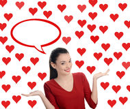 Beautiful brunette girl raising her hand presenting. Valentine day. Royalty Free Stock Photo