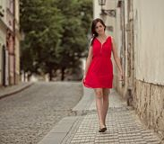 Beautiful brunette girl with red outfit Stock Image