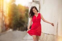 Beautiful brunette girl with red outfit Royalty Free Stock Image