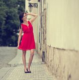 Beautiful brunette girl with red outfit Stock Photos