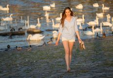 Beautiful brunette girl at the river Stock Photo