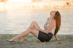 Beautiful brunette girl at the river Stock Photography