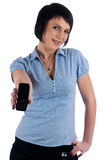 Beautiful brunette girl shows mobile on phone Stock Images