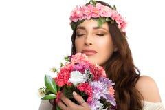 Beautiful Brunette Girl Smelling Fresh Spring Flowers Stock Images