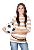Beautiful brunette girl with soccer ball Stock Photography