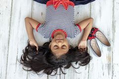Beautiful brunette girl with striped dress royalty free stock photos