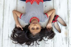 Beautiful brunette girl with striped dress stock image