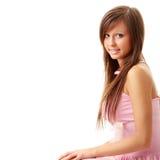 Beautiful brunette girl in sweet pink. Stock Photo