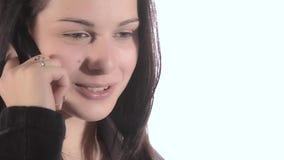 Beautiful brunette girl talking on the mobile stock video