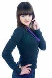 Beautiful brunette girl talking on phone Stock Photo