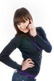 Beautiful brunette girl talking on phone Royalty Free Stock Image
