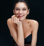 Beautiful brunette girl toothy smiling with lipstick. stock photos