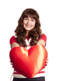 Beautiful brunette girl with toy heart. Royalty Free Stock Images