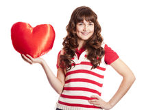 Beautiful brunette girl with toy heart. Stock Image