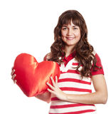 Beautiful brunette girl with toy heart. Stock Photography