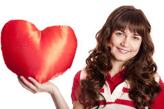 Beautiful brunette girl with toy heart. Stock Photos