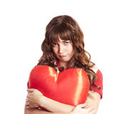 Beautiful brunette girl with toy heart. Royalty Free Stock Photo