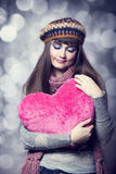 Beautiful brunette girl with toy heart. Photo for st. Valentine Royalty Free Stock Images