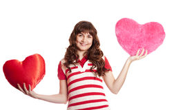 Beautiful brunette girl with toy hearts. Royalty Free Stock Photography