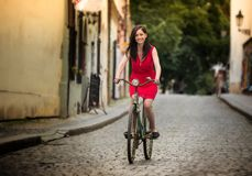 Beautiful brunette girl on a vintage bike Royalty Free Stock Image